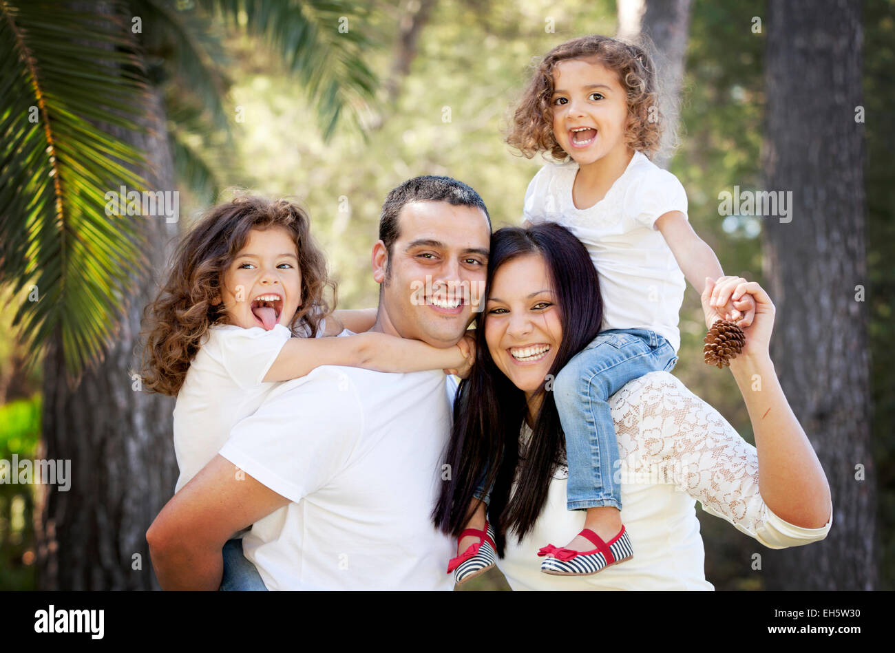parents and children, happy smiling Hispanic family - Stock Image