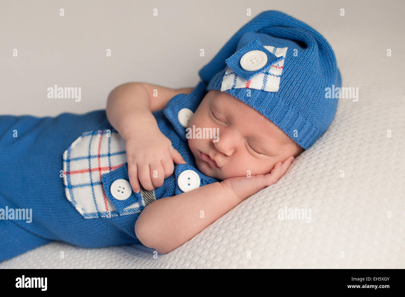 d0365af8d1f1 Sleeping Baby Boy Wearing an Up-Cycled Romper and Cap Stock Photo ...