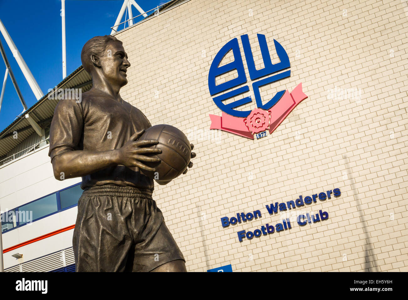 Bronze statue of Nat Lofthouse, Bolton Wanderers legend, outside the Macron (formerly Reebok) Stadium in Horwich, - Stock Image