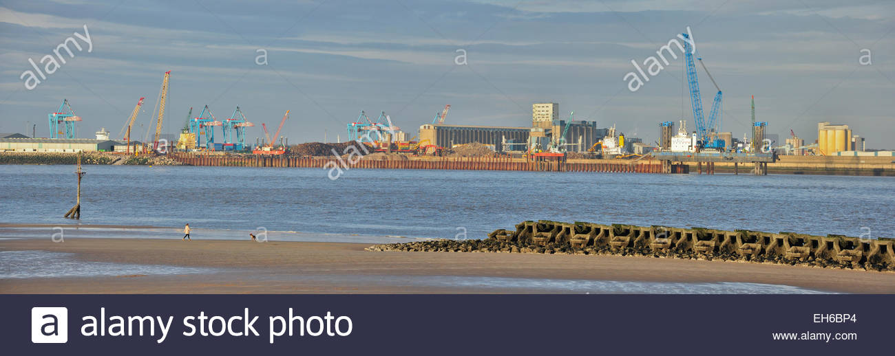 The Seaforth docks in Liverpool, viewed from across the River Mersey at New Brighton, Wallasey, Wirral, UK - Stock Image