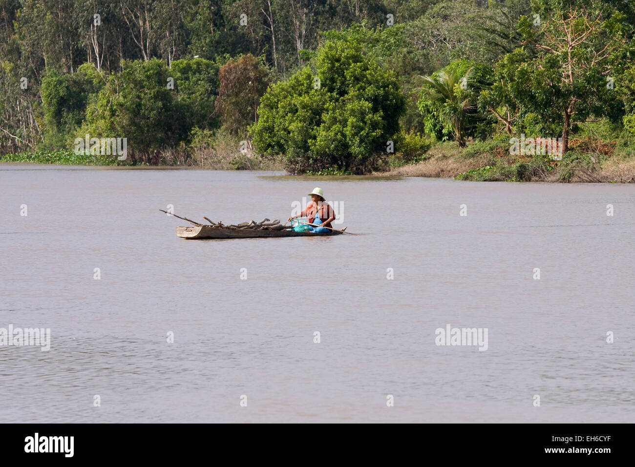 A man is riding in a canoe on the Mekong, Mekong Delta, Vietnam, Asia - Stock Image
