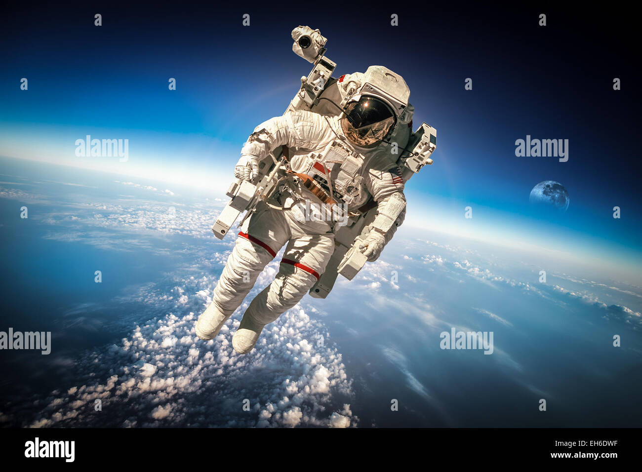 Astronaut in outer space against the backdrop of the planet earth. Elements of this image furnished by NASA. - Stock Image