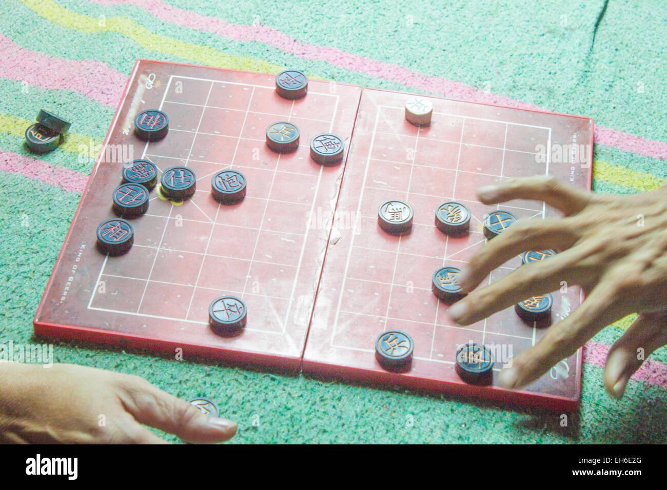 Two men playing, vietnamese chess board game, XiangQi - Stock Image