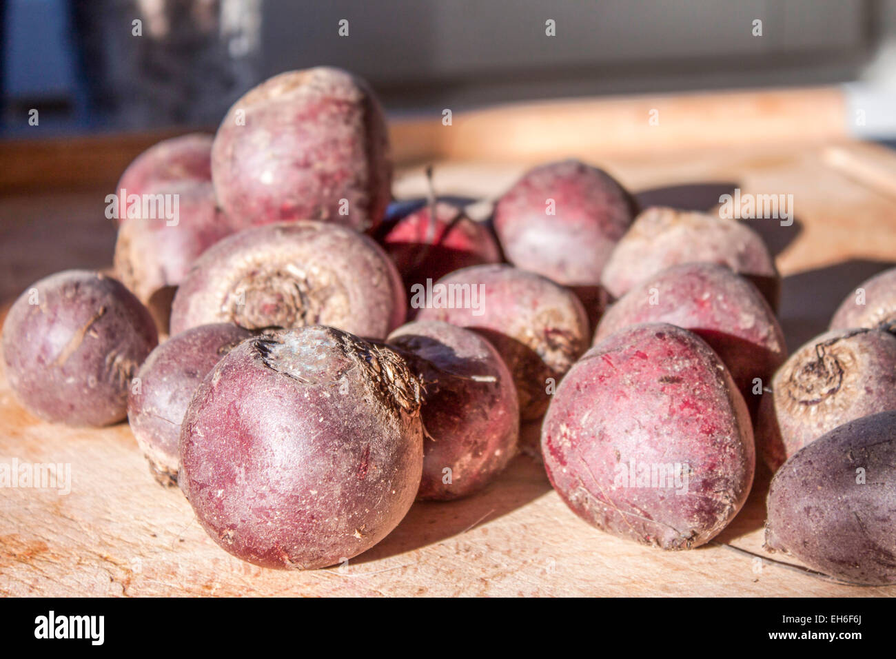 Fresh, purple beetroots, on a wooden cutting board Stock Photo