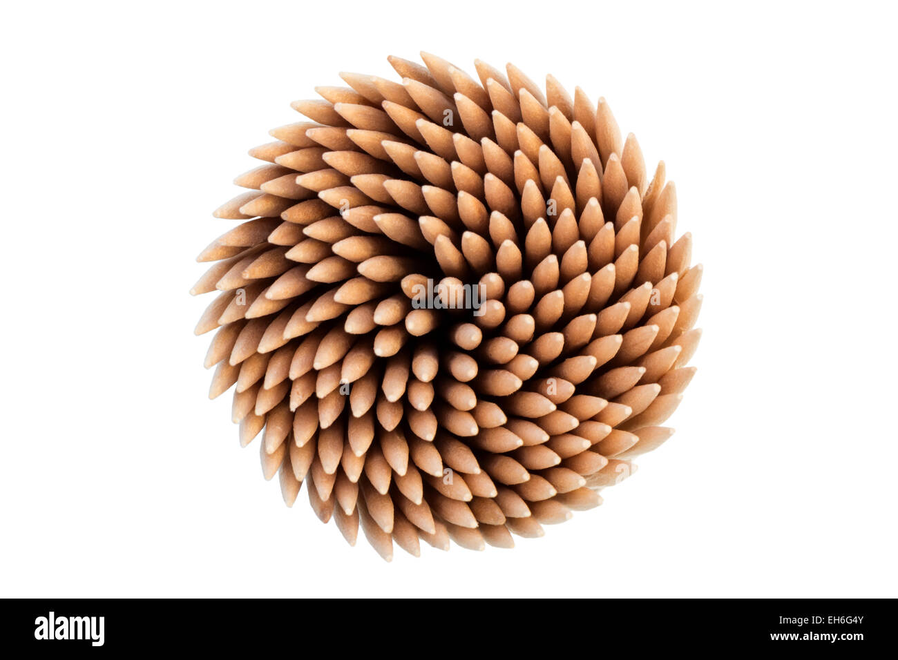Stack of wooden toothpicks or cocktail sticks viewed from above, isolated on white background - Stock Image