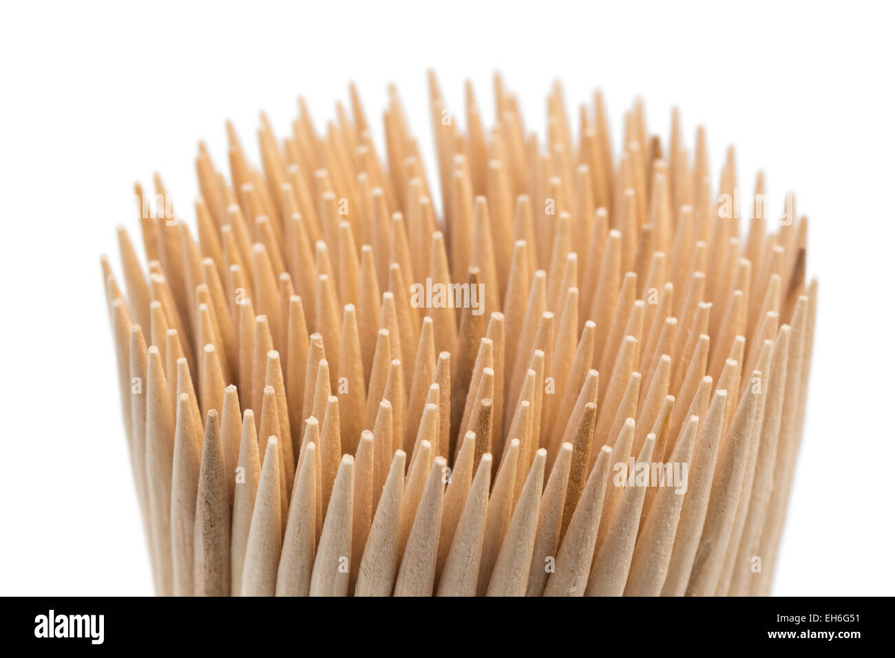 Closeup of stack of wooden toothpicks or cocktail sticks, isolated on white background - Stock Image