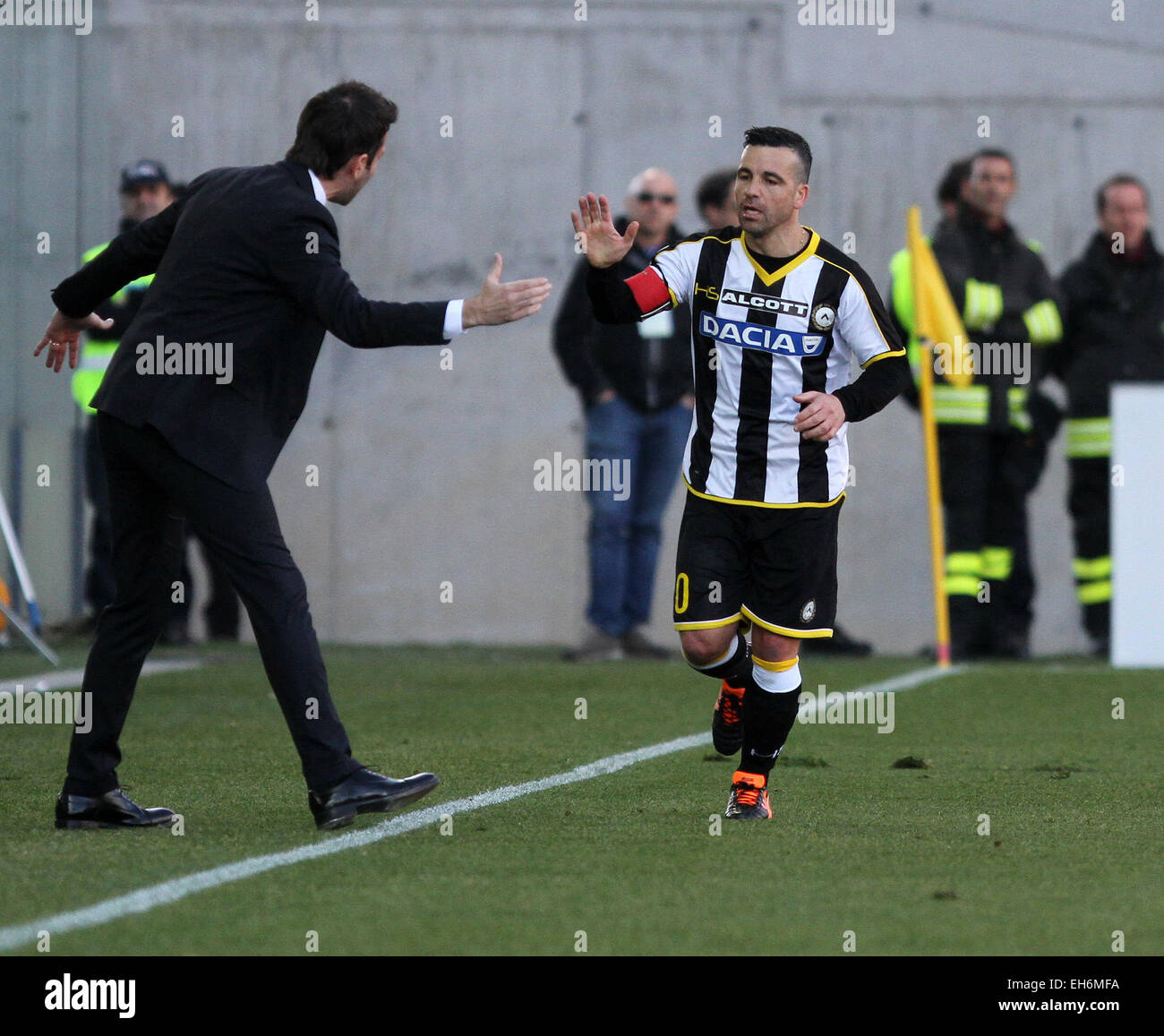 Udine, Italy. 8th March, 2015. Udinese's forward Antonio Di Natale celebrates goal 1-1 with Udinese's coach Andrea Stock Photo