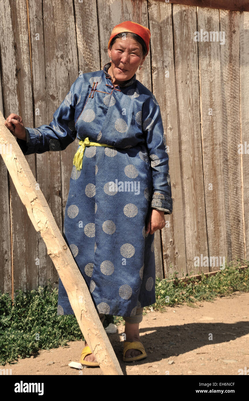 Jargalant, Old Lady In Traditional Costume And Wooden Fence