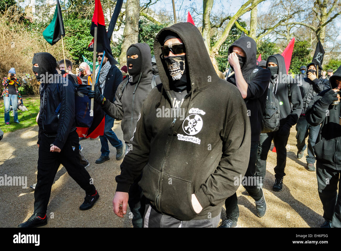 London, UK. 7th March, 2015  'Time for Action' climate change march.  Pictured: Anti-capitalist demonstrators - Stock Image