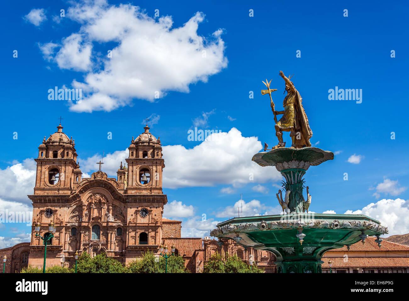 Church and Incan fountain in the Plaza de Armas of Cusco, Peru - Stock Image