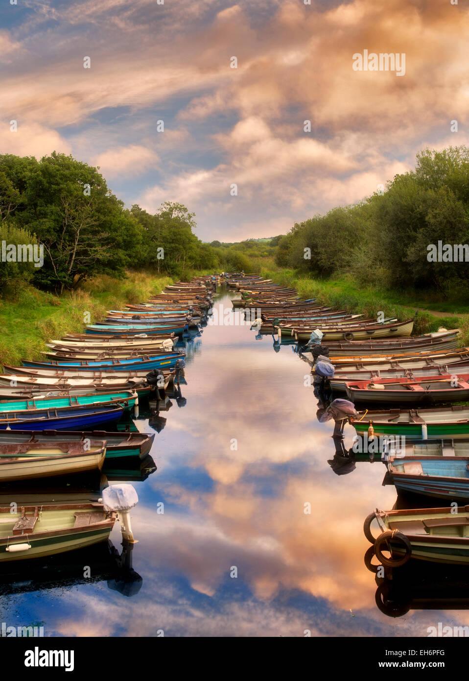 Fishing boats in small inlet. Killarney National Park, Ireland. - Stock Image