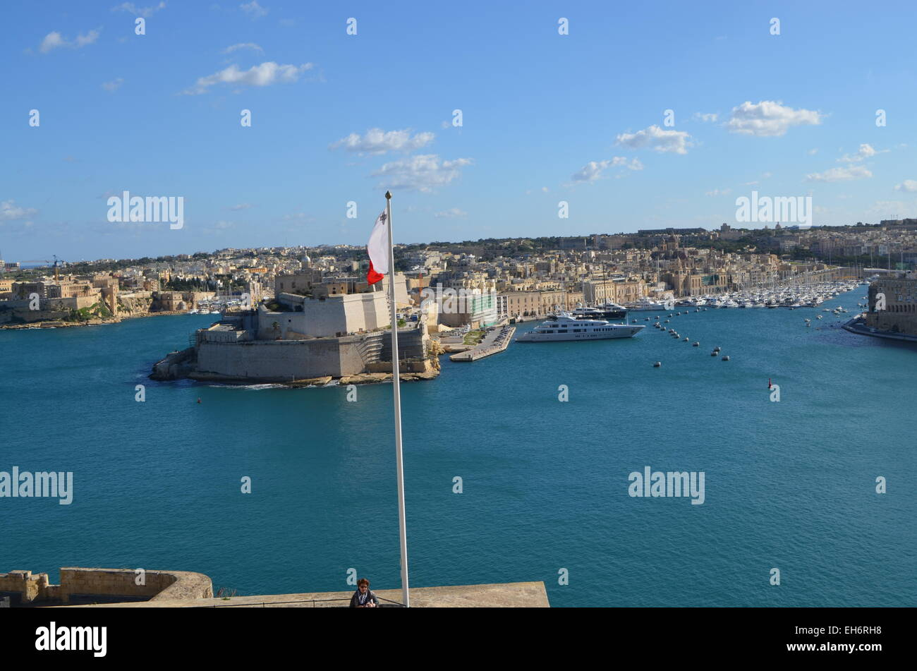 Malta, Valletta, a view The Grand Harbour with Fort St. Angelo to the left and the many sailing boats of the populace - Stock Image