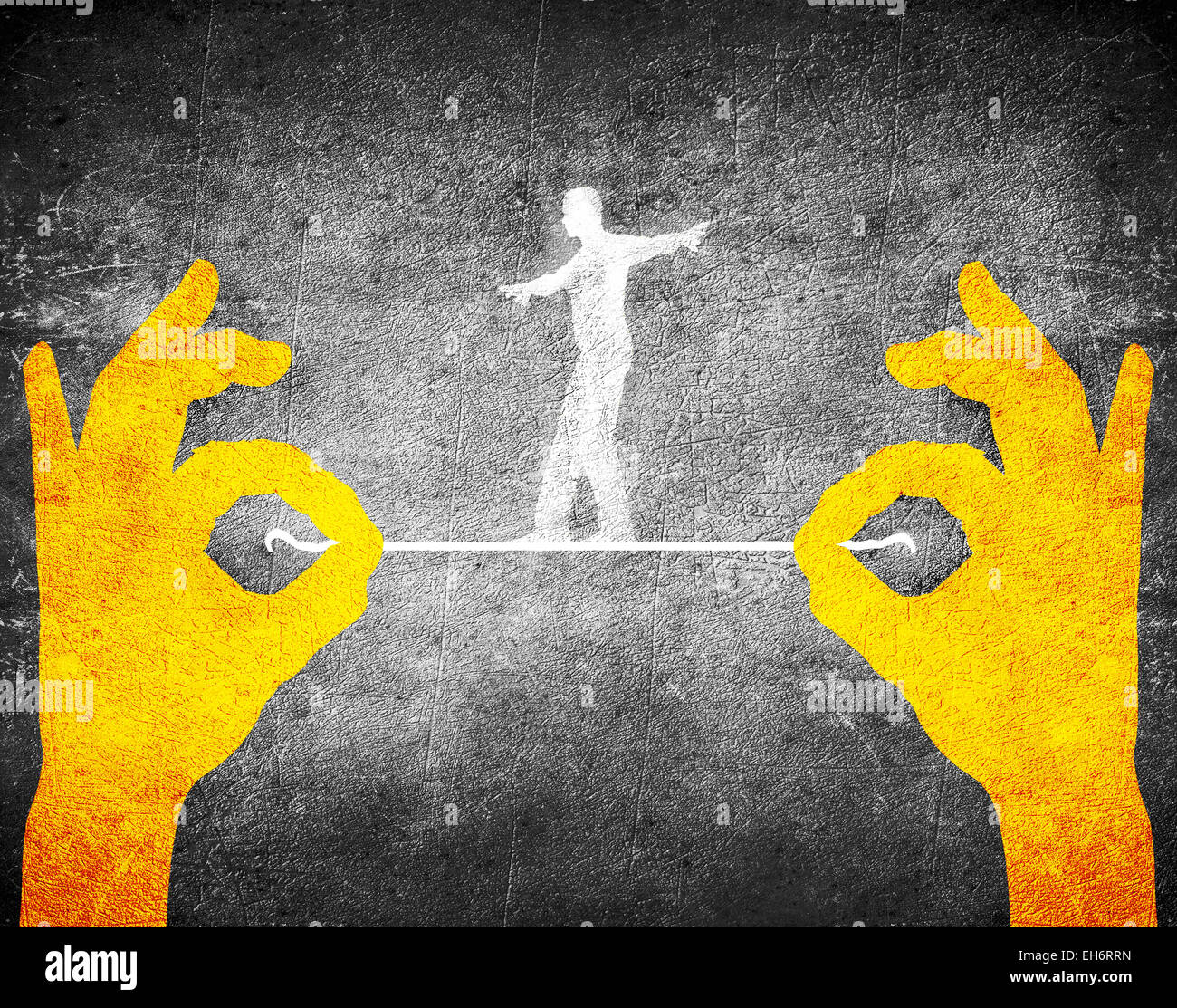 orange hands and tightrope walker - Stock Image