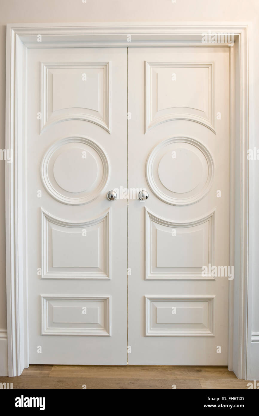 Ornate White Double Doors In A Grand House With Fine
