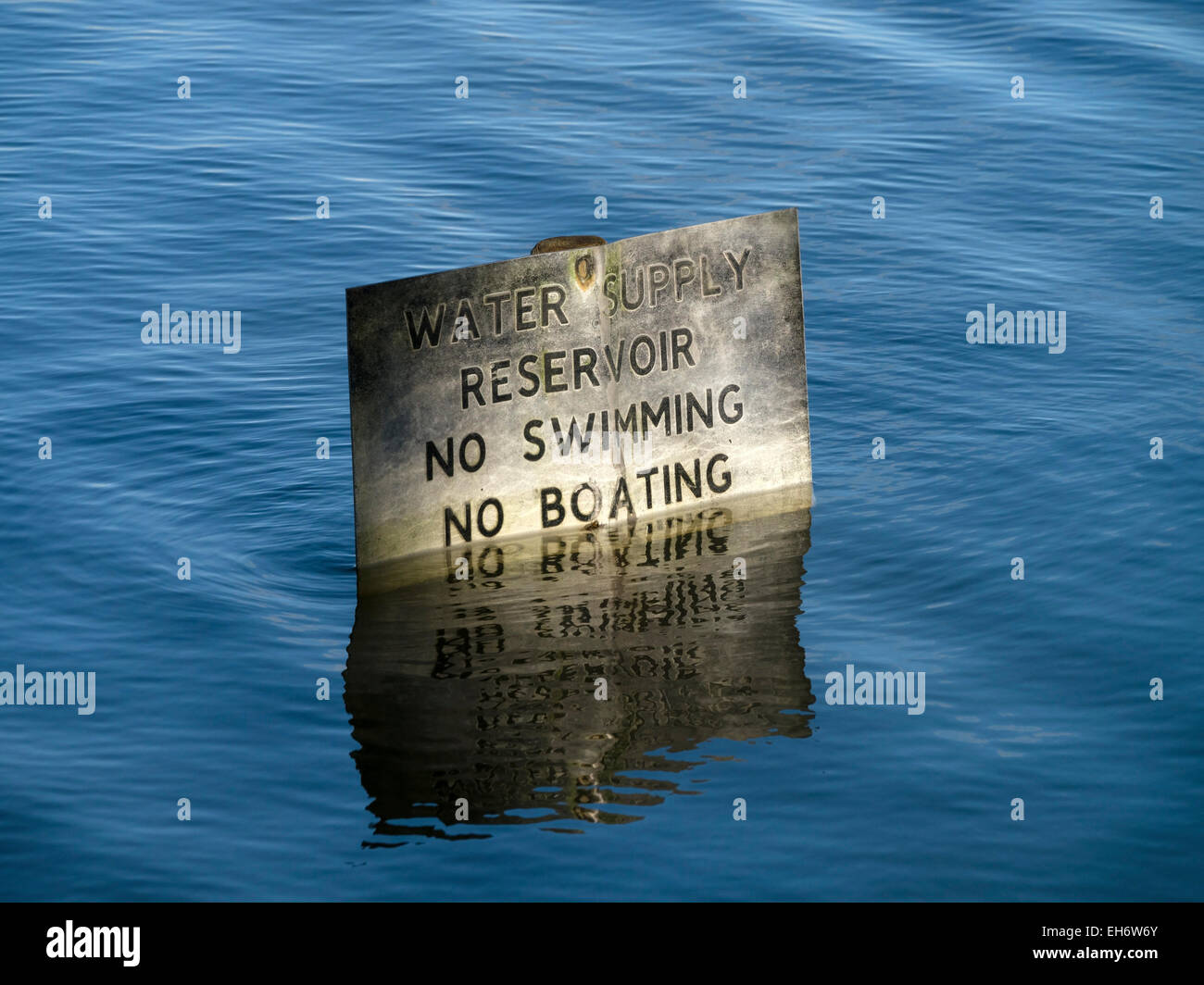 Partially submerged 'No swimming, No boating, Water supply Reservoir' sign, Staunton Harold Reservoir, Ashby - Stock Image