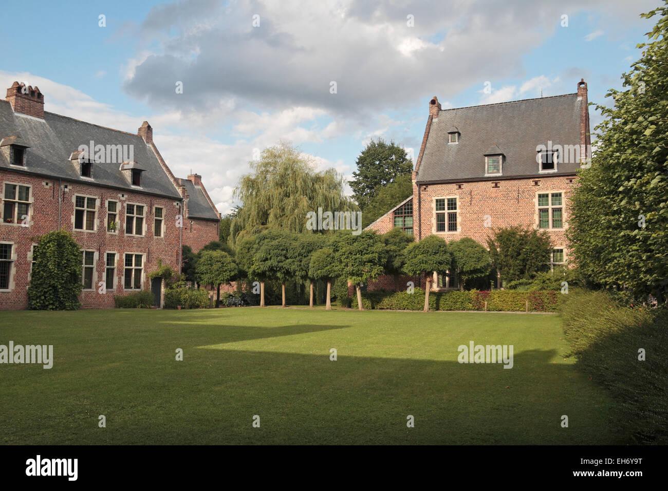 Grass area inside the peaceful Grand Béguinage (Groot Begijnhof), Leuven, Flemish Brabant, Belgium. - Stock Image