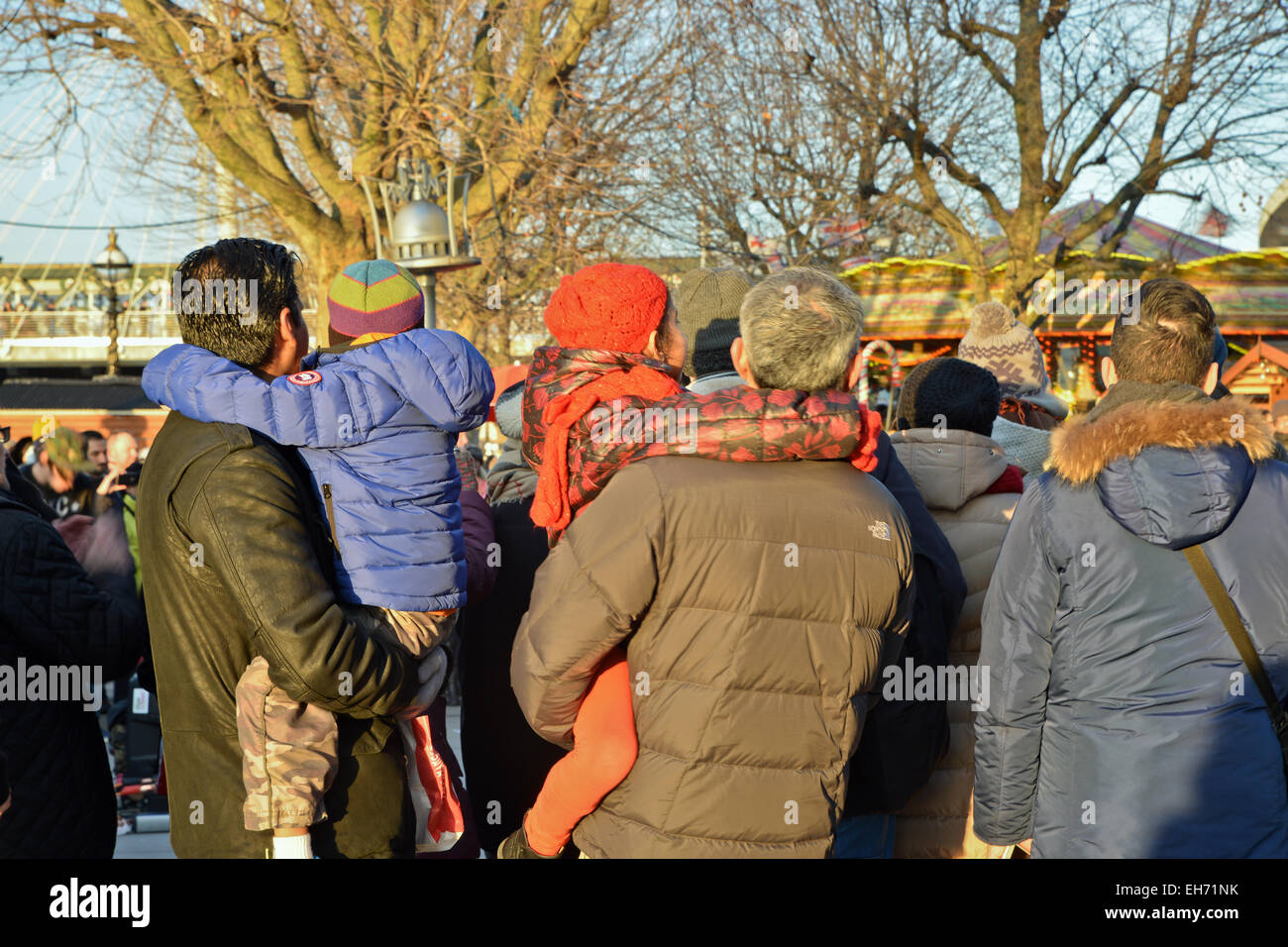 Tourist onlookers on the Embankment London UK - Stock Image