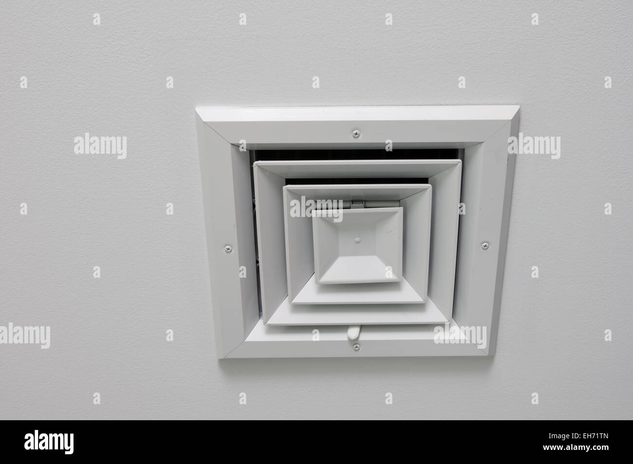 angled view of a ceiling air vent on a white ceiling - Stock Image