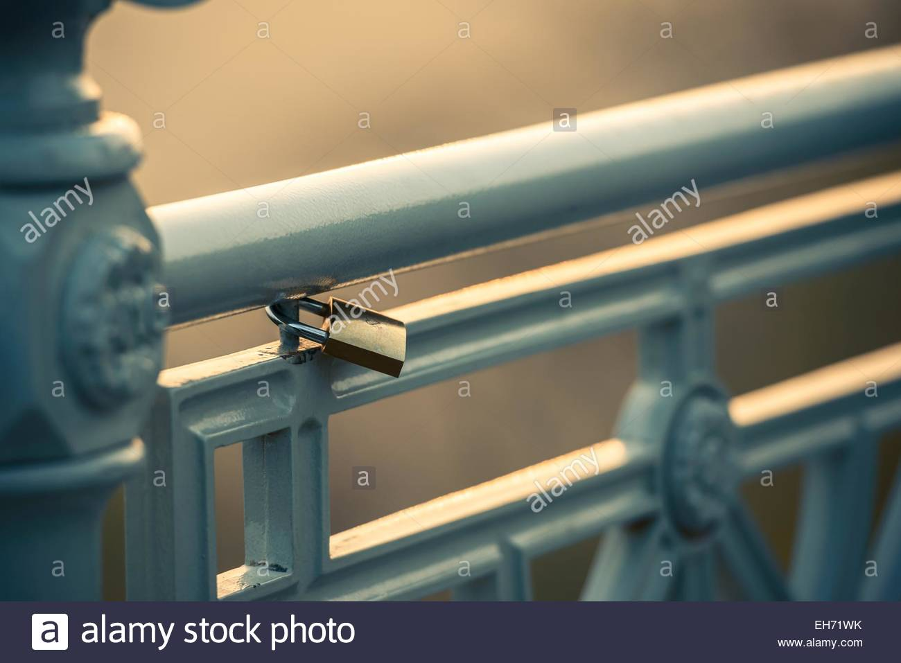 Padlock on fence, symbol of love - Stock Image