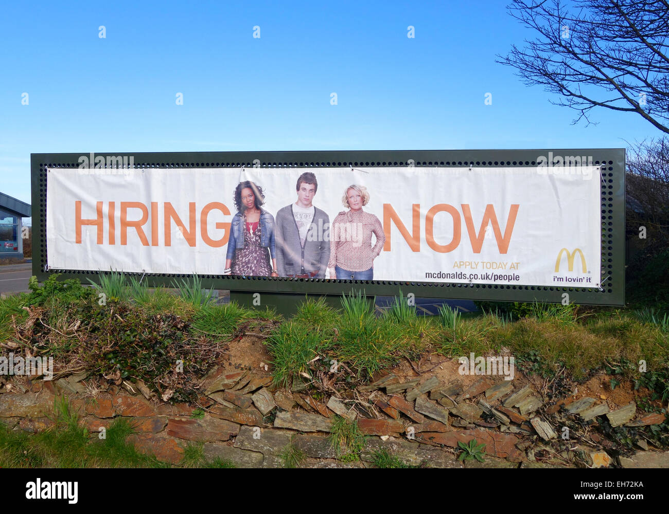a hiring now sign outside a mcdonalds - Stock Image