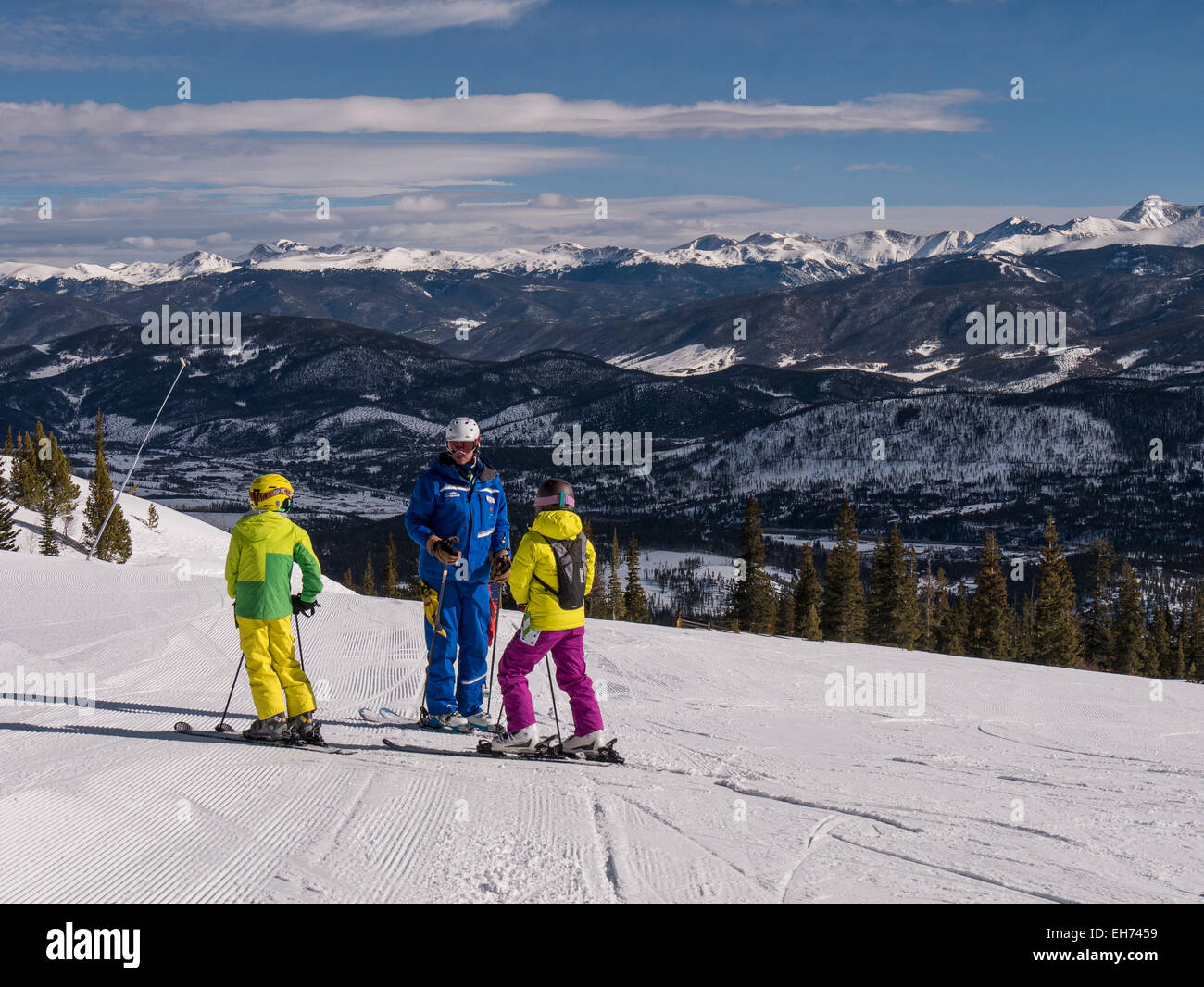 Young skiers and instructor at the top of the Colorado Super Chair, Peak 8, Breckenridge Ski Resort, Breckenridge, - Stock Image