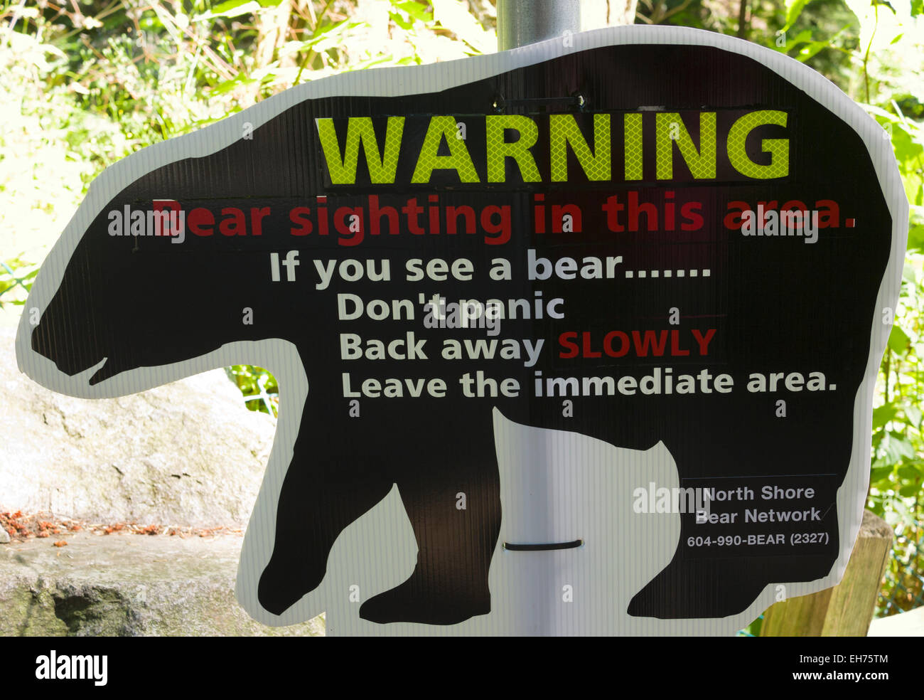 Bear warning sign, Lighthouse Park, Point Atkinson, West Vancouver, BC, Canada - Stock Image