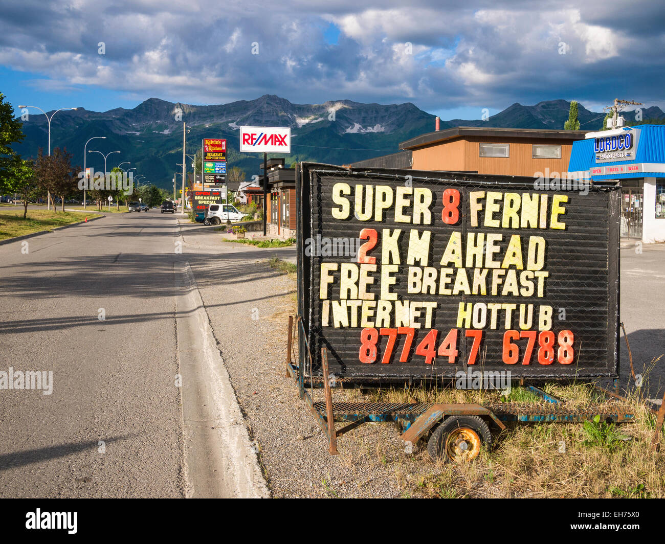 Advertising for 'Super 8' motel, Fernie, BC, Canada.  The city of Fernie is encircled by the Rocky Mountains - Stock Image