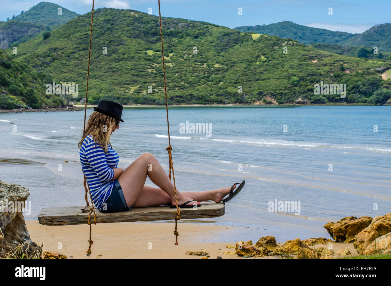 clear, clothes, clothing, company, crossed, crossing, day, distance, expanse, environment, feet, foot, footwear, famous, hat, swing, seascape, peacefu Stock Photo