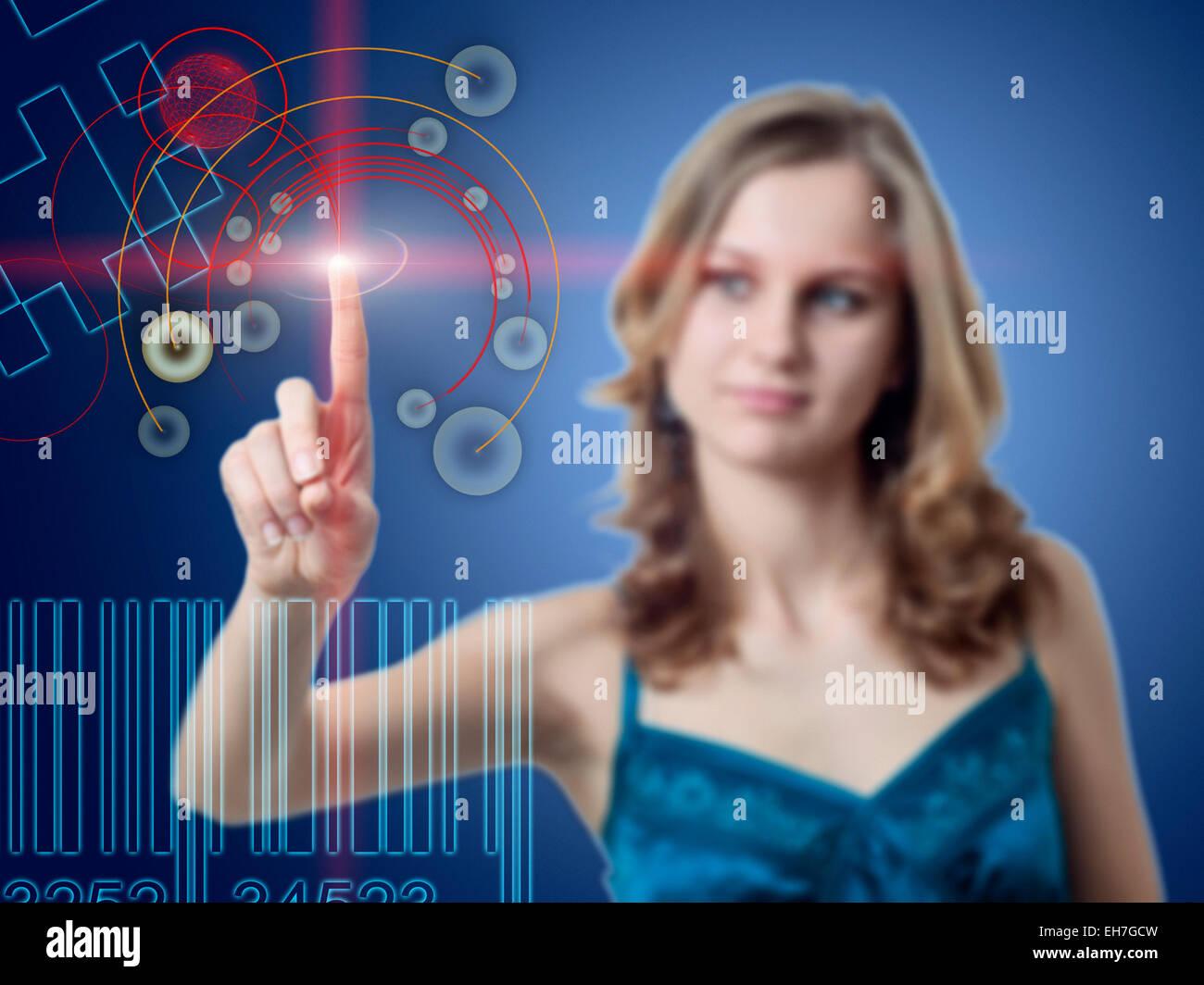 Woman using touchscreen technology - Stock Image