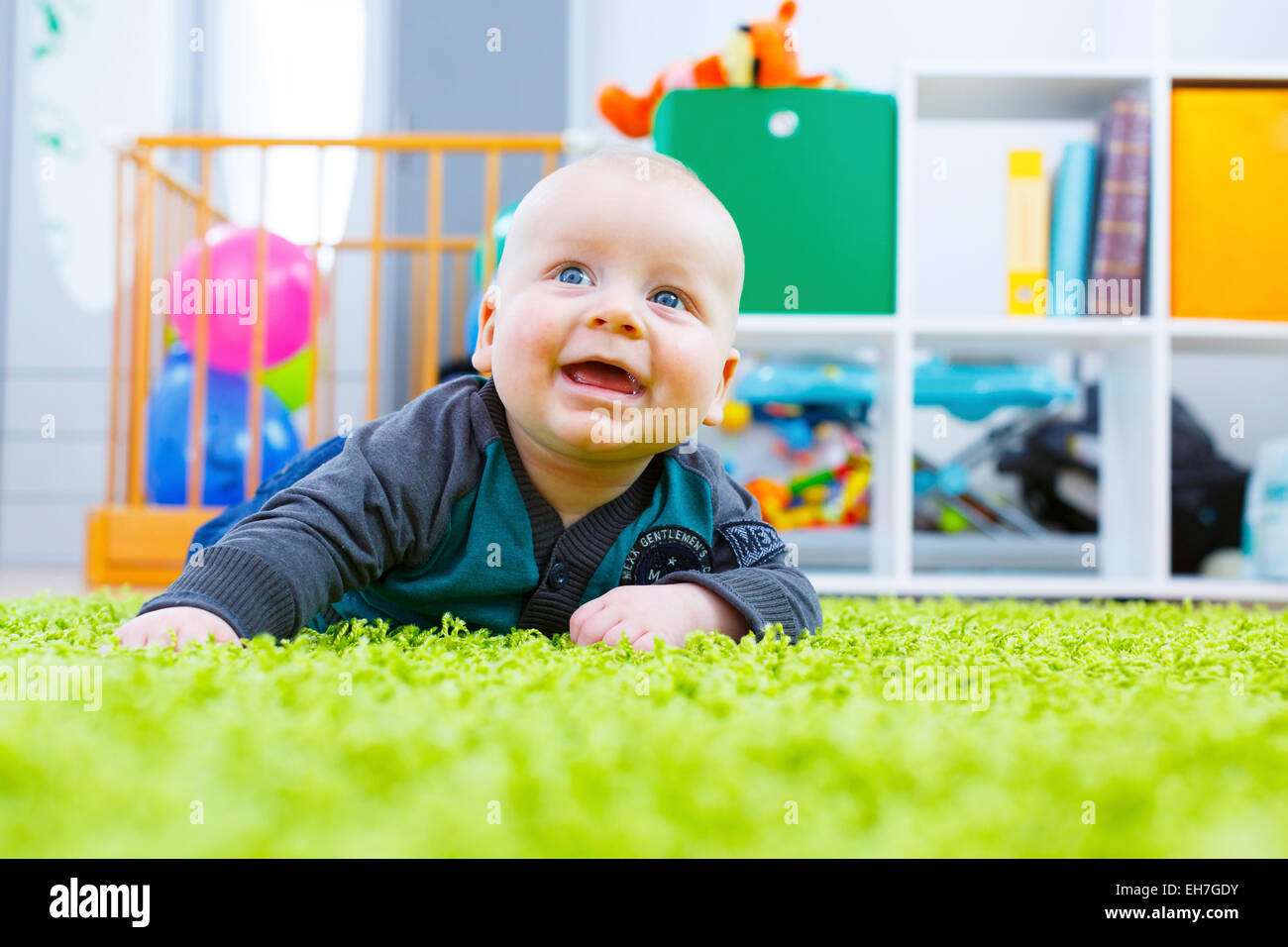 Baby crawling in nursery - Stock Image