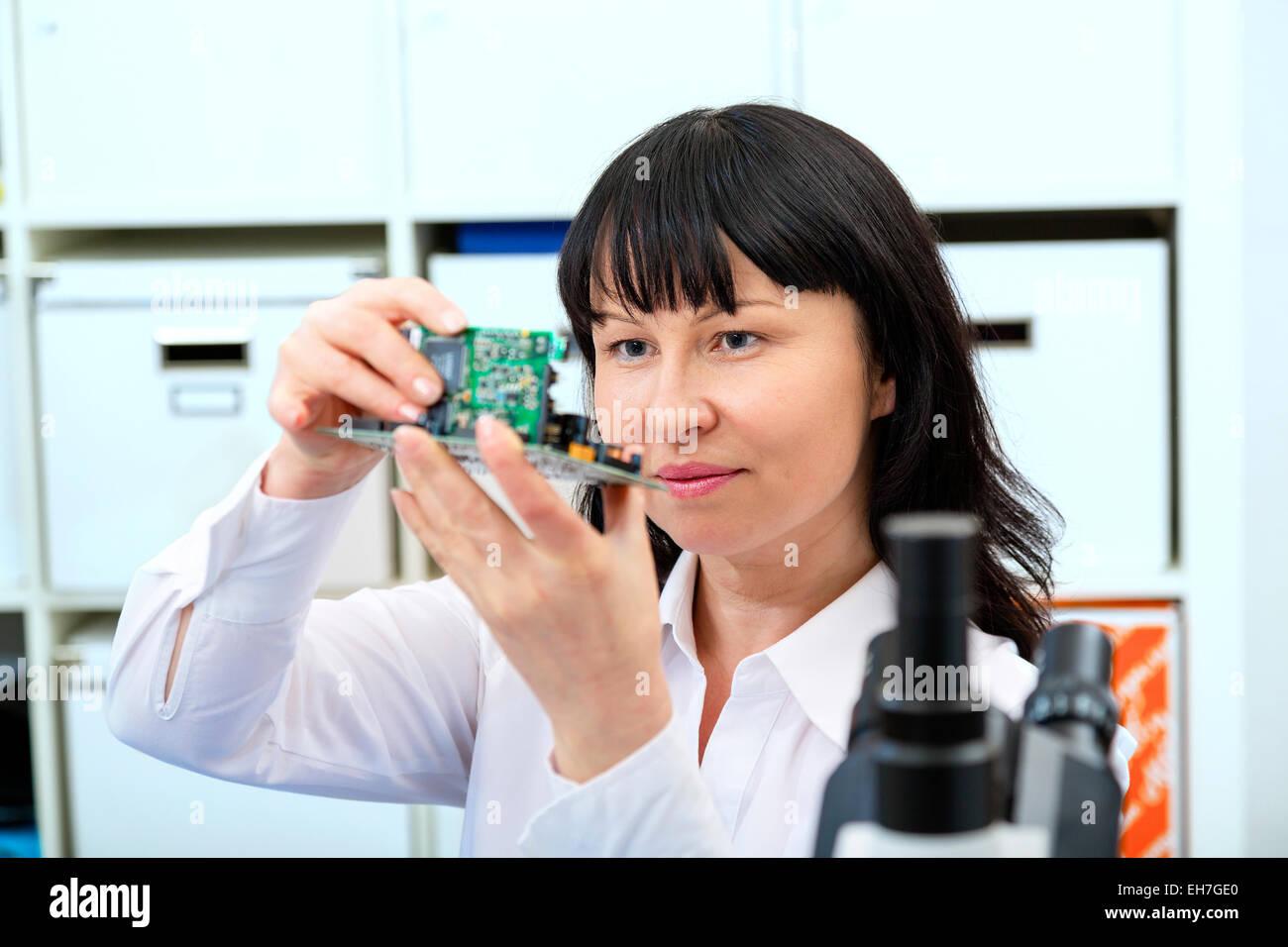 Woman making a micro processor - Stock Image