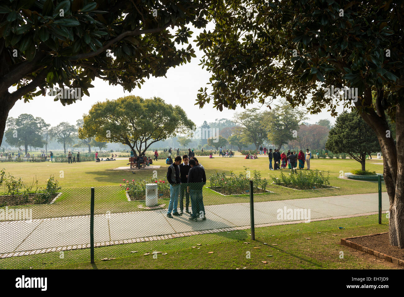 Families relaxing in the Rose Garden in the central park of Chandigarh, India - Stock Image