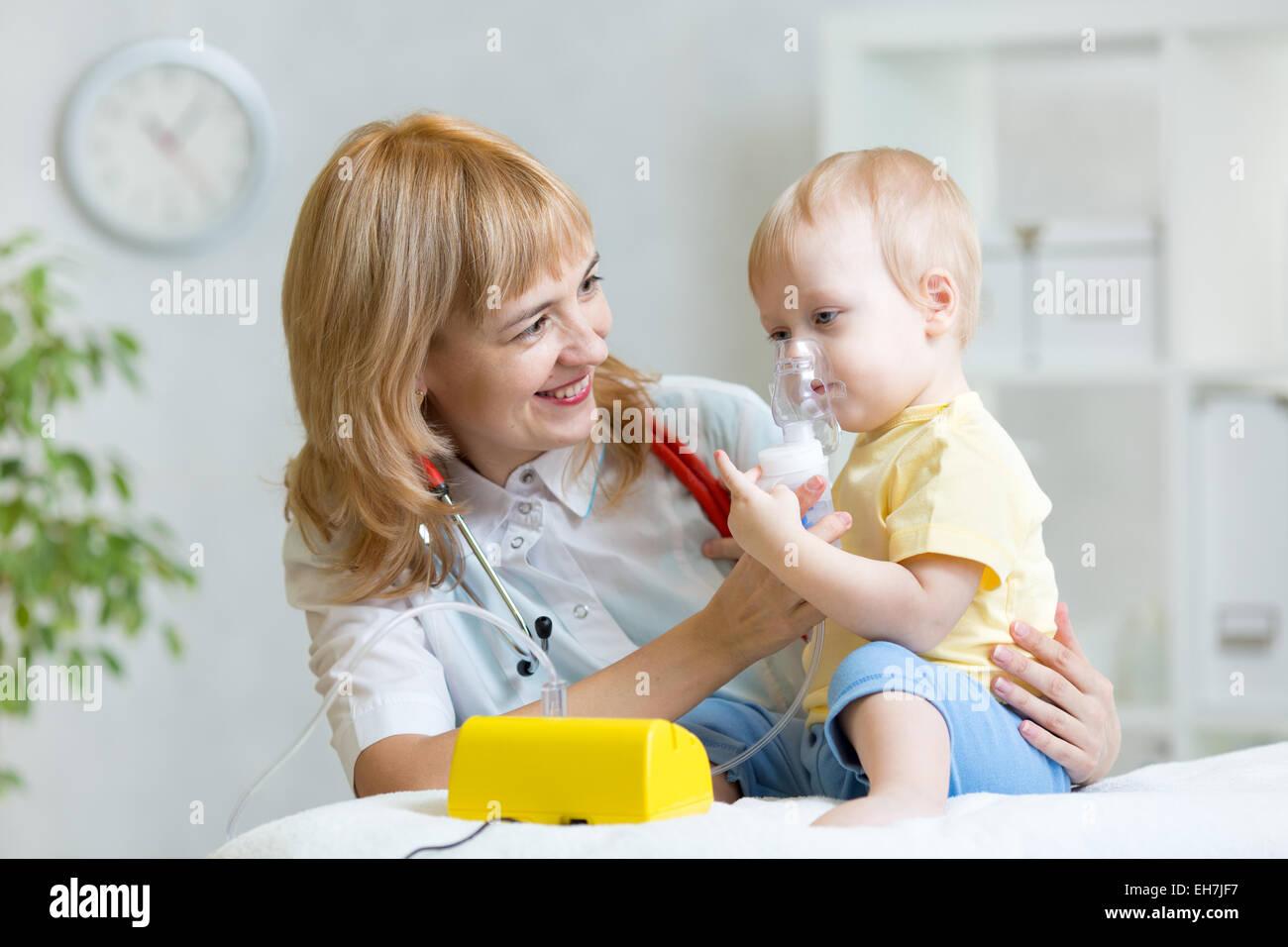 Doctor holding inhaler mask for kid breathing - Stock Image