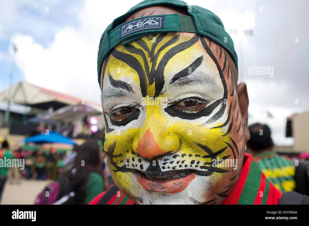 Adelaide Australia. 9th March 2015. Bangladesh cricket fans show spirit in contrast to the Barmy Army fans ahead - Stock Image