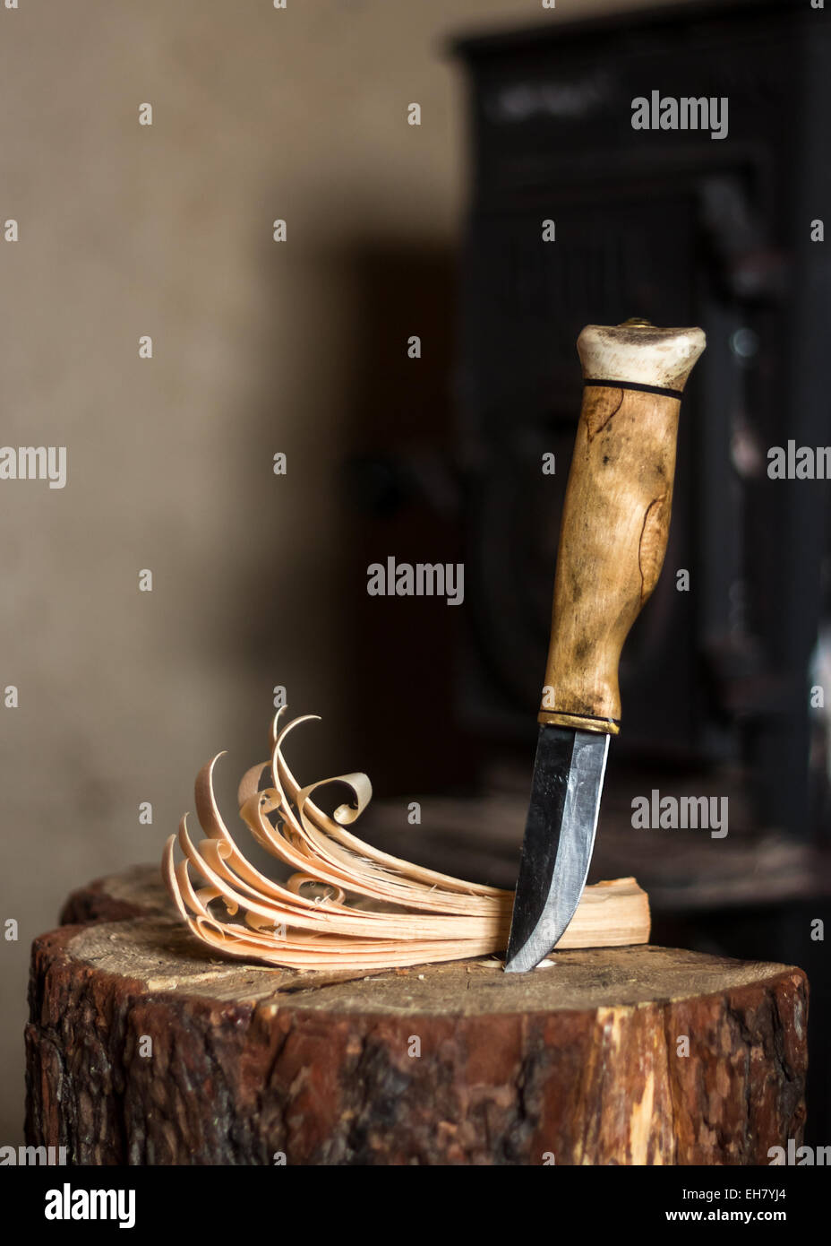 A traditional Finnish knife (puukko) and a feather stick. - Stock Image