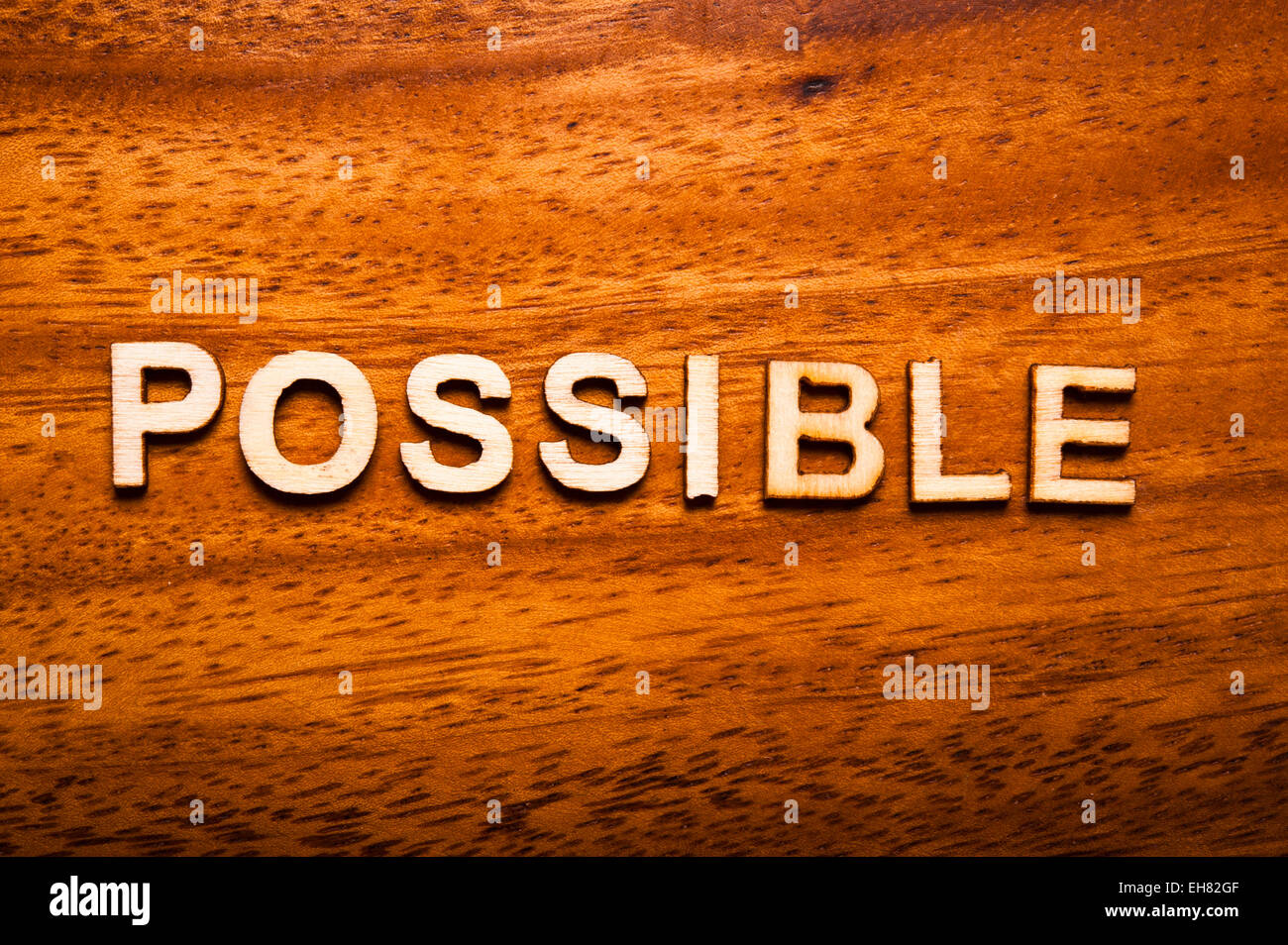 word possible written with wooden letters - Stock Image