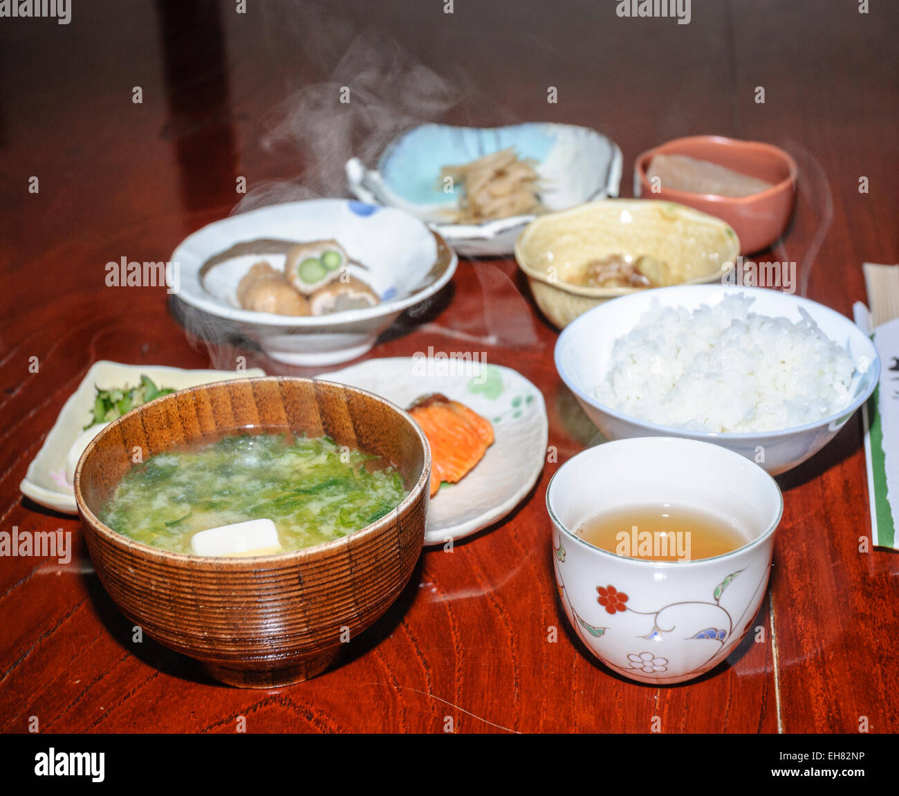 Steaming hot food in a traditional Japanese meal: several courses of the evening meal are served at the same time. - Stock Image