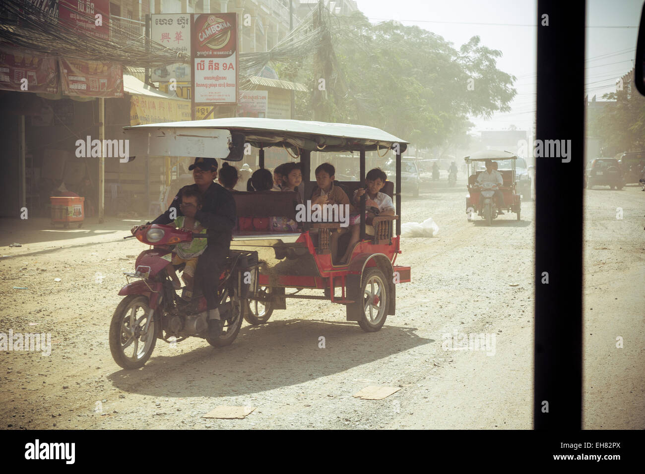 Tuk Tuk ride on a dusty road, Phnom Penh, Cambodia, Indochina, Southeast Asia, Asia - Stock Image