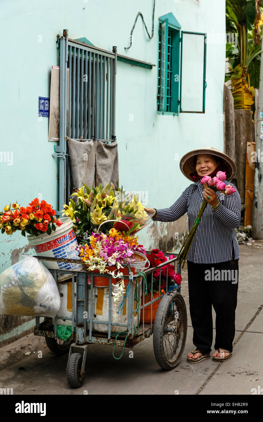 Flower seller, Can Tho, Mekong Delta, Vietnam, Indochina, Southeast Asia, Asia - Stock Image