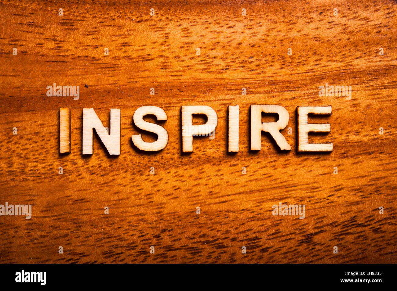 word inspire wrritten with wooden letters - Stock Image