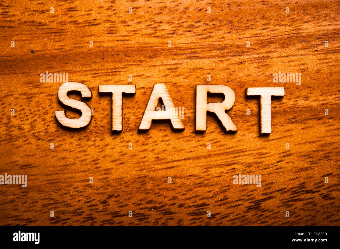word start written with wooden letters - Stock Image