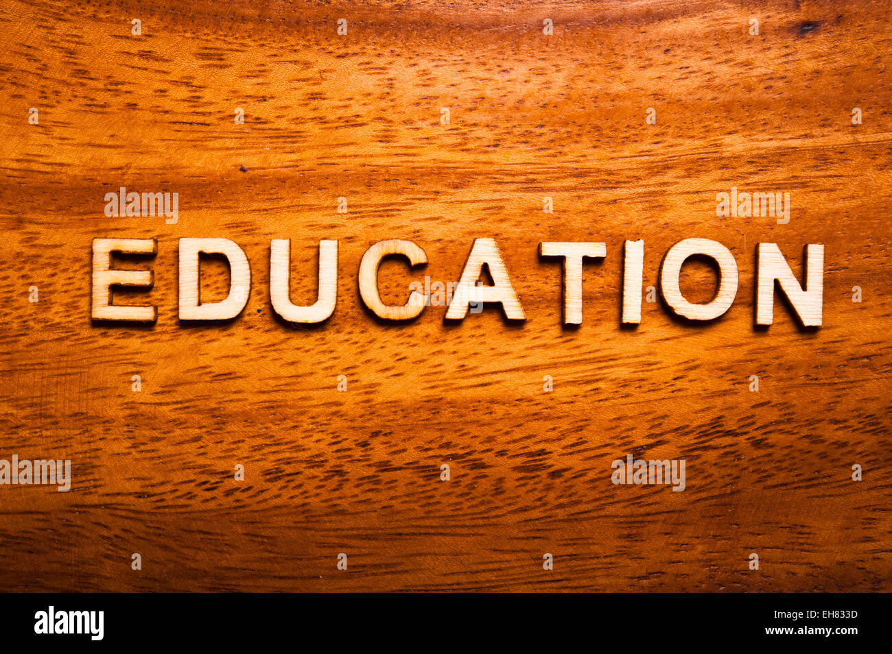 word education written with wooden letters - Stock Image