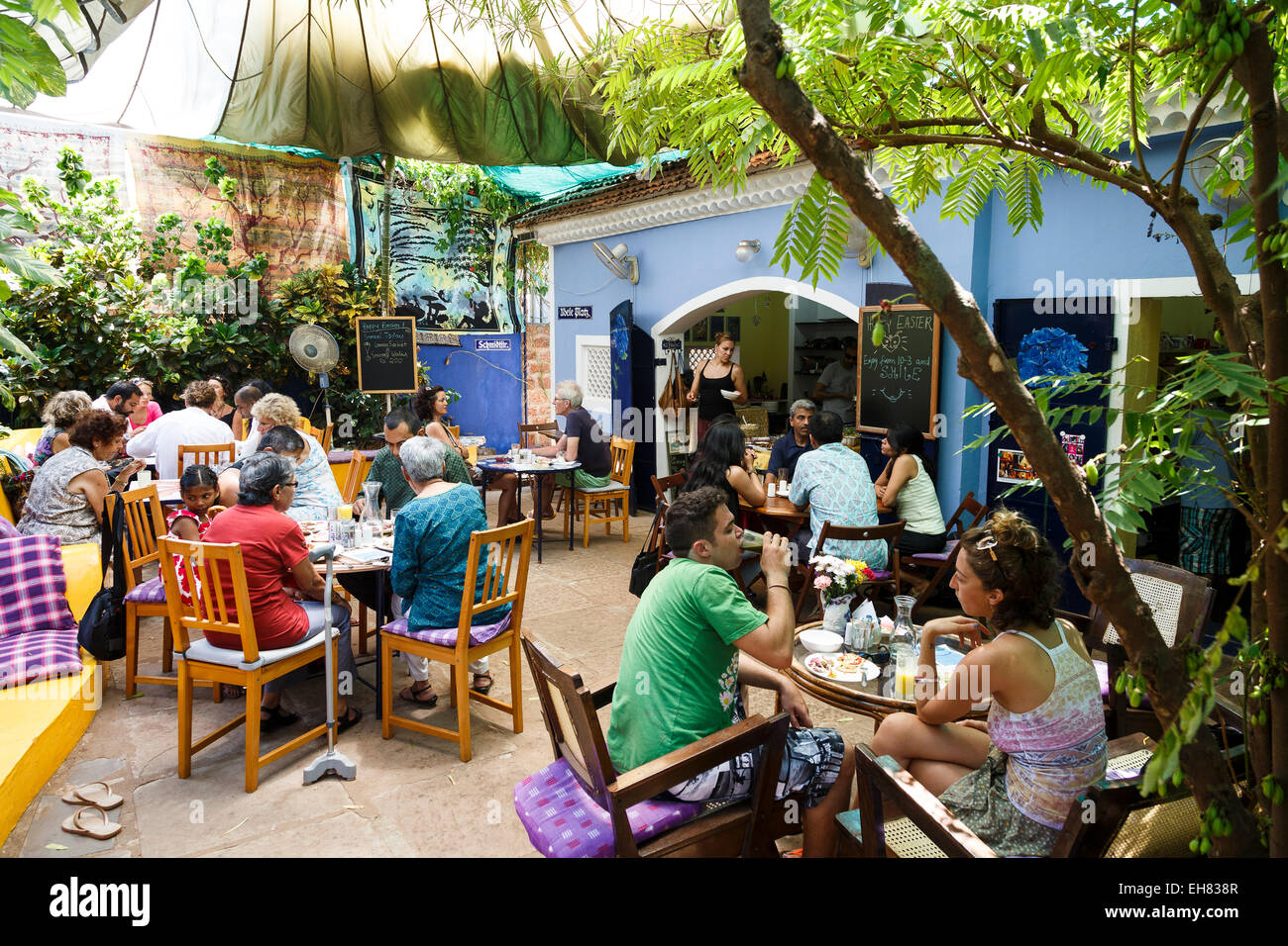 People sitting at the Villa Blanche Bistro, Assagao, Goa, India, Asia - Stock Image