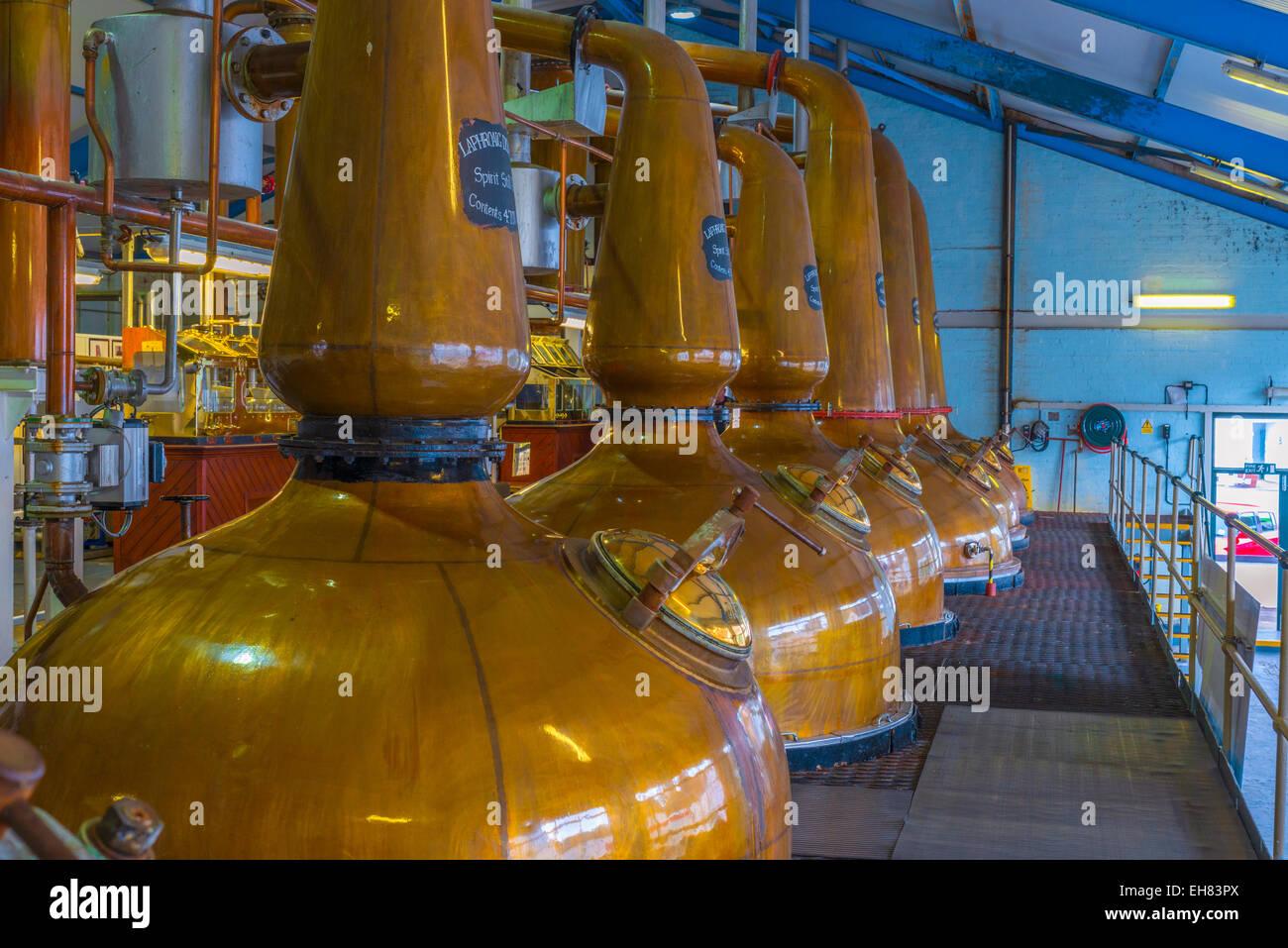 Copper pot stills, Laphroaig Whisky Distillery, Islay, Argyll and Bute, Scotland, United Kingdom, Europe - Stock Image