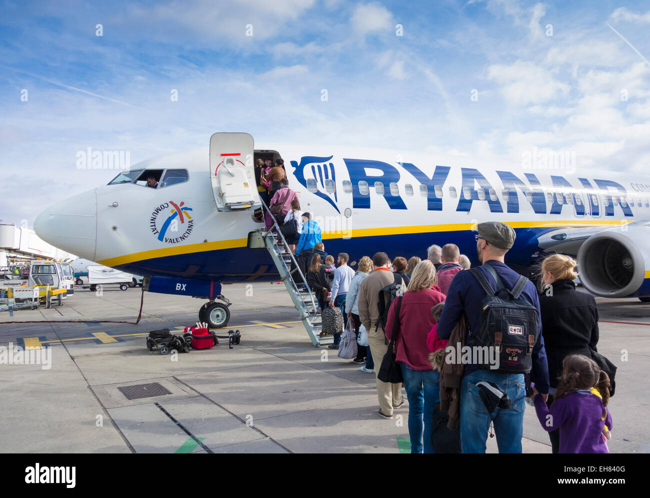 Passengers boarding Ryanair plane at Manchester Airport. England. UK - Stock Image