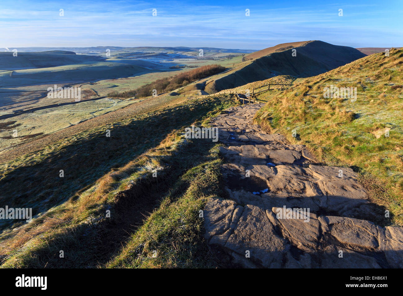 Steps up Mam Tor, view towards Rushup Edge, distant fields and hills in winter, Castleton, Peak District, Derbyshire, - Stock Image