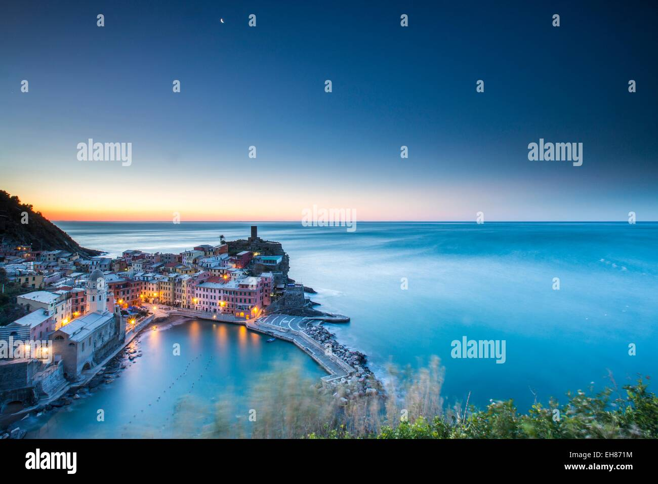 The blue hour in Vernazza, one of the many little villages in the Cinque Terre National Park, UNESCO, Liguria, Italy - Stock Image