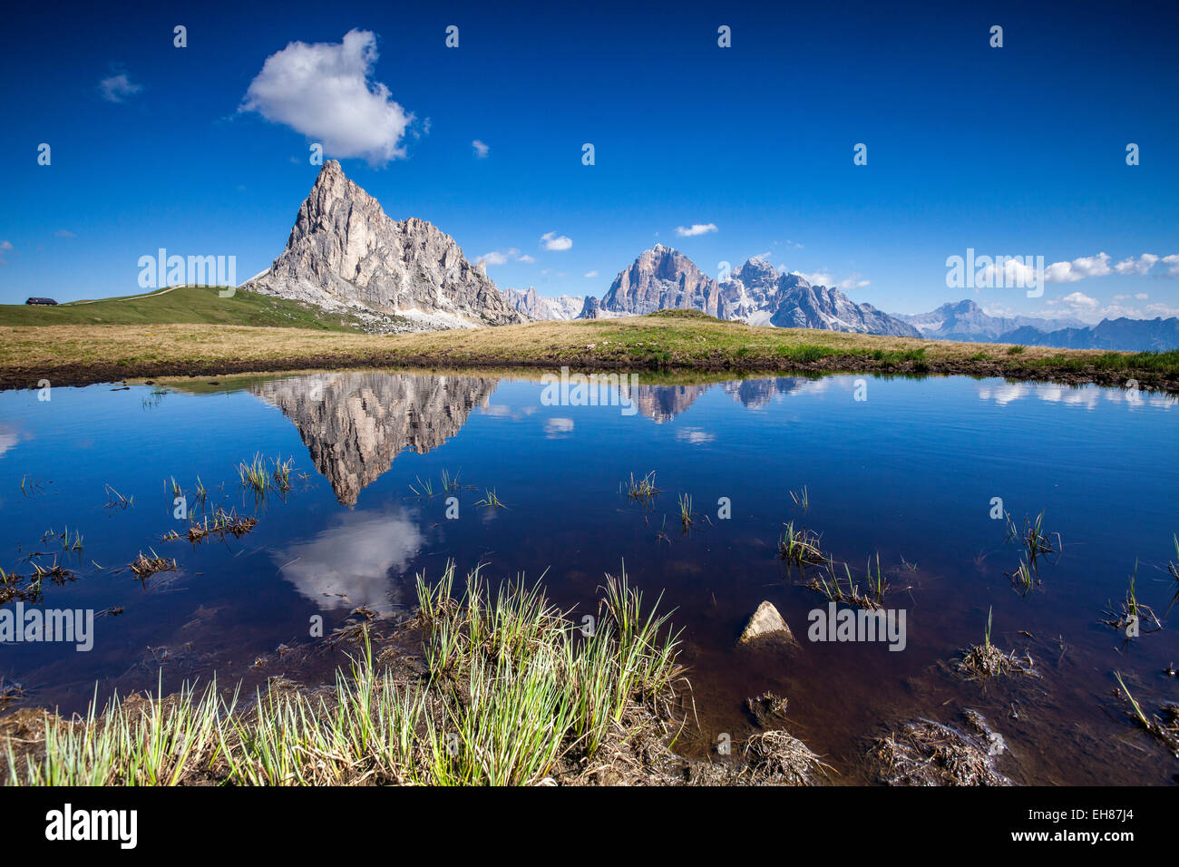 The Gusela peak and the Tofane Group by Cortina D'Ampezzo reflecting in the lake by Passo Giau, Veneto, Italy, - Stock Image