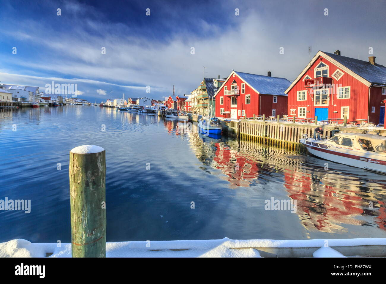 View of colorful fishermen's houses and private boats overlooking the canal-port of Henningsvaer, Lofoten Islands, Stock Photo