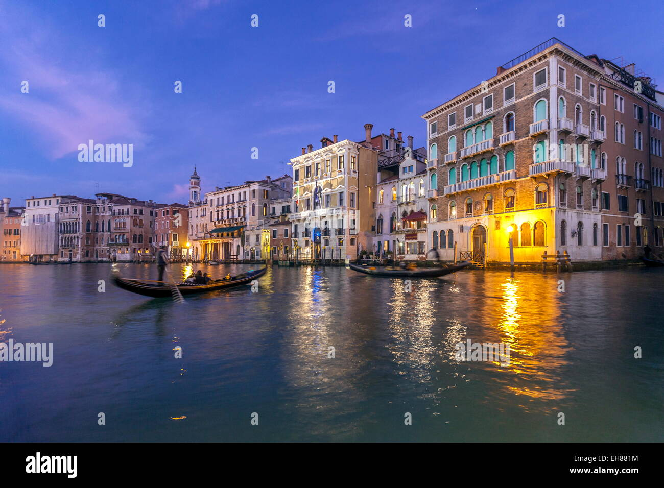 Gondolas crossing the Grand Canal at the blue hour, Venice, UNESCO World Heritage Site, Veneto, Italy, Europe - Stock Image